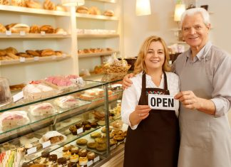 Senior couple on an opening day of their own bakery